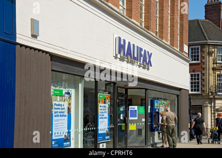 Older couple at an ATM outside Halifax Bank York North Yorkshire England UK United Kingdom GB Great Britain - Stock Photo