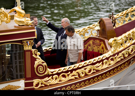 Lord Sterling of Plaistow (left) & boatbuilder Mark Edwards (right) looking over the Queen's Royal Barge 'Gloriana'. - Stock Photo