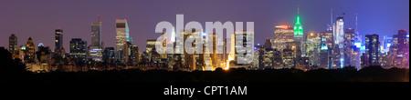 Panorama of midtown Manhattan at night in New York City - Stock Photo