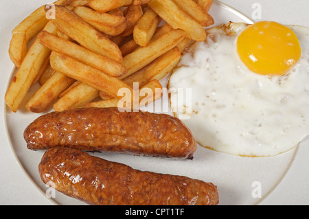 Sausage, egg and chips - Stock Photo