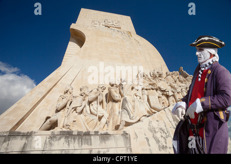 Monument to the Discoveries and man in period costume, Lisbon, Portugal - Stock Photo