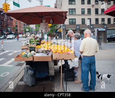 A fruit and vegetable stand in the Chelsea neighborhood of New York on Saturday, May 26, 2012. (© Richard B. Levine) - Stock Photo