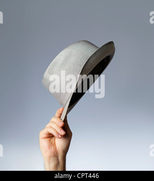 Man tipping his vintage trilby hat. - Stock Photo