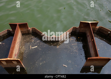 Construction girders used as bulkhead in water - Stock Photo