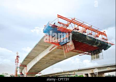 Bridge under construction in Bangkok, Thailand, viewed from below. - Stock Photo