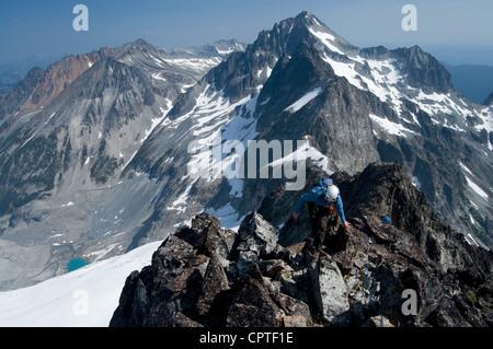 Female climber on mountain summit, Redoubt Whatcom Traverse, North Cascades National Park, WA, USA - Stock Photo