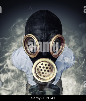 funny portrait of man with gas mask and smoke - Stock Photo
