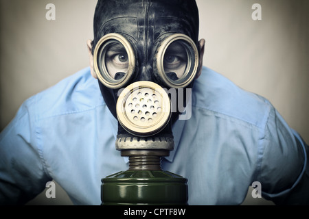 portrait of man wearing classic russian gas mask - Stock Photo