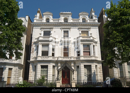 large detached 1862 house, with a grade II listing,  in italianate style, now divided into flats in holland park, - Stock Photo