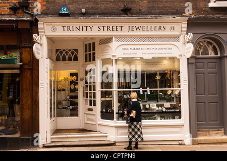 A woman window shopping in Trinity Street Jewellers in Cambridge , England , Britain , Uk - Stock Photo