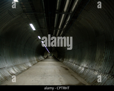 View down the entrance tunnel toward the offices and storage chambers in the Svalbard Global Seed Vault. - Stock Photo