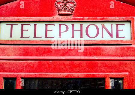 Close-up of an iconic red British telephone box. - Stock Photo