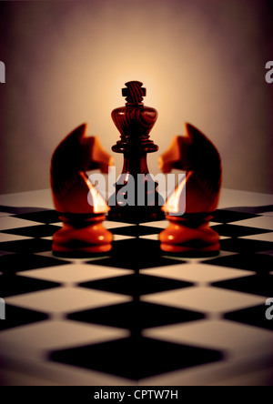 Black king with light behind, two white knights mirrored for symmetry, on diagonal chess board - Stock Photo