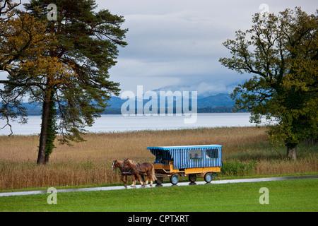Tourist bus at Konigschloss Herrenchiemsee castle on Herren Insel island in Chiemsee Lake, Baden-Wurttenberg, Bavaria, - Stock Photo