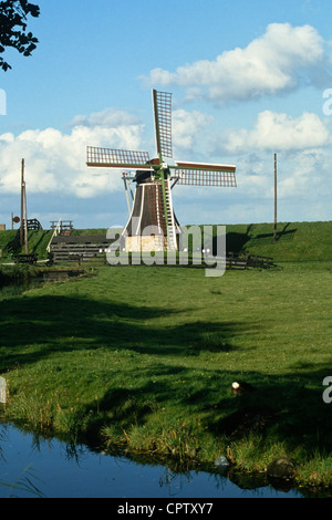 A windmill (molen) keeps the polder dry in the Zuiderzeemuseum in Enkhuisen, Holland - Stock Photo