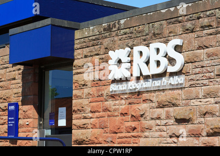 Royal Bank of Scotland sign in Gaelic language with RBS symbol. Scotland UK Britain - Stock Photo