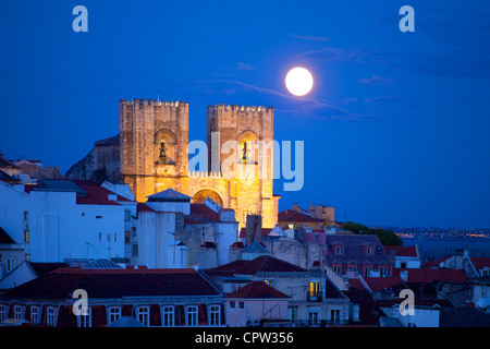 Patriarchal Cathedral of St. Mary Major, Lisbon, Portugal at twilight with moon rise - Stock Photo