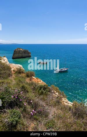 Excursion boats off Praia da Marinha beach near Benagil, on the coast between Portimao and Albufeira, Algarve, Portugal - Stock Photo