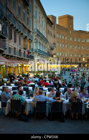 Diners eating al fresco at Nannini bar and restaurant in Piazza del Campo, Siena, Italy - Stock Photo
