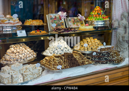 Cakes, sweets and pastries in shop window of luxury patticeria, caffe sweet shop Gilli, in Florence, Tuscany, Italy - Stock Photo