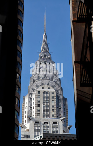 Chrysler Building viewed down an alley, New York City. - Stock Photo