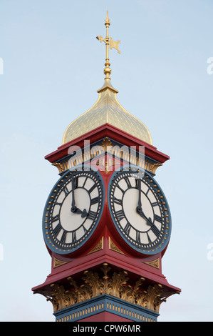 The freshly painted victorian Jubilee clock tower on Weymouth seafront was erected in 1887 to mark fifty years of - Stock Photo