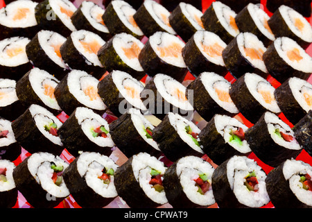 traditional japanese cuisine- sushi rolls served at a party - Stock Photo