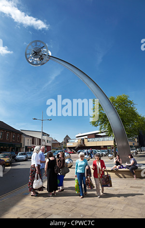 People in shopping centre with modern clock, Ebbw Vale, Wales, UK - Stock Photo