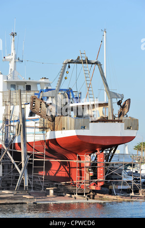 Commercial fishing boat in dry dock for repair - Stock Photo