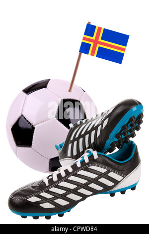 Pair of cleats or football boots with a small flag of  - Stock Photo