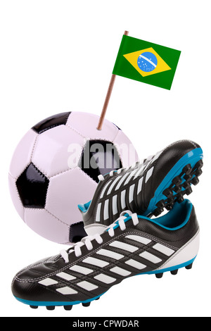 Pair of cleats or football boots with a small flag of Brazil - Stock Photo