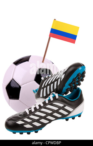 Pair of cleats or football boots with a small flag of Colombia - Stock Photo