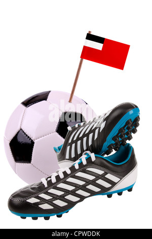 Pair of cleats or football boots with a small flag of Georgia - Stock Photo