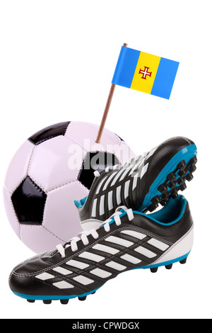 Pair of cleats or football boots with a small flag of Madeira - Stock Photo