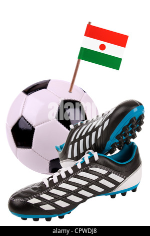 Pair of cleats or football boots with a small flag of Niger - Stock Photo