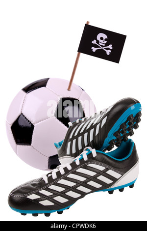 Pair of cleats or football boots with a small pirate vlag - Stock Photo