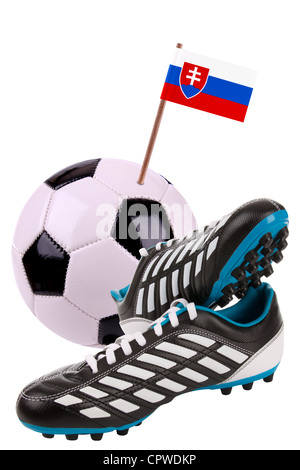 Pair of cleats or football boots with a small flag of Slovaka - Stock Photo