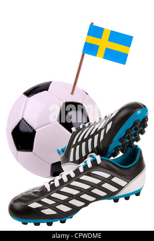 Pair of cleats or football boots with a small flag of Sweden  - Stock Photo
