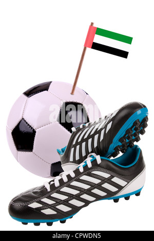 Pair of cleats or football boots with a small flag of United Arab Emirates - Stock Photo