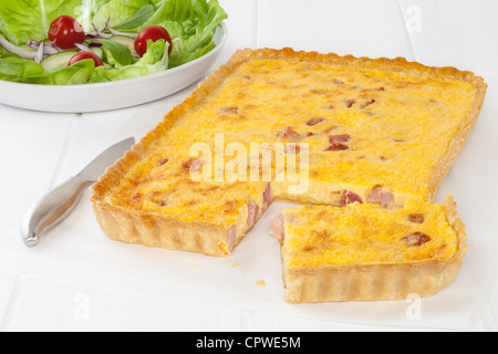 French classic, homemade Quiche Lorraine with salad - Stock Photo