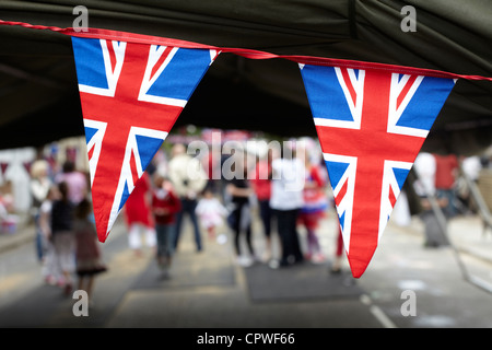 Union Flag bunting at a street party - Stock Photo