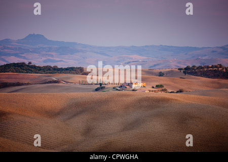 Typical Tuscan landscape near San Quirico D'Orcia in Val D'Orcia, Tuscany, Italy - Stock Photo
