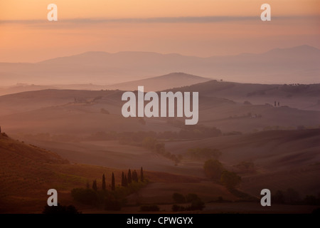Tuscan landscape of hill slopes in Val D'Orcia, Tuscany, Italy - Stock Photo