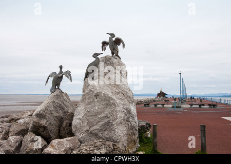 The Stone Jetty in the seaside town of Morecambe in Lancashire, UK. The sculptures are of sea birds made from cast - Stock Photo