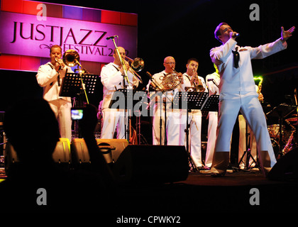 Navy Musician 3rd Class Gabriel Brown with U.S. Navy 7th Fleet Band, Orient Express, sings at a jazz festival during - Stock Photo