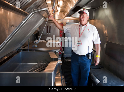 American Red Cross disaster relief volunteer displays mobile kitchen during training exercise - Stock Photo