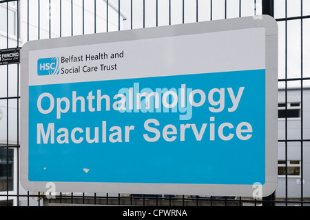 Sign for 'Opthalmology Macular Service' outside a gate into a hospital. - Stock Photo