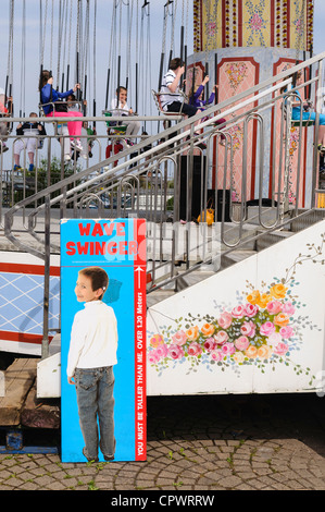 Height restriction sign on 'Chairplanes' fairground ride - Stock Photo