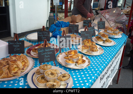 Savory pastries and pies on sale at Bovey Tracey Farmers Market Devon England - Stock Photo