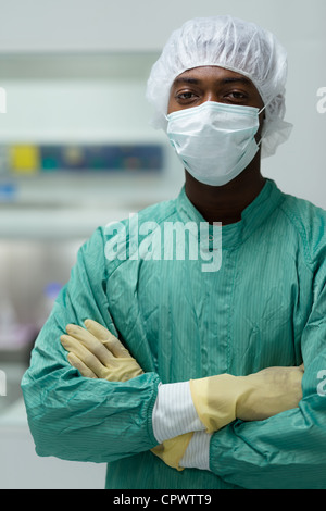 Portrait of man working as researcher in biotechnology industry - Stock Photo